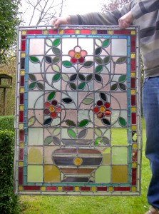 The rescued stained glass panel is quite extensivly damaged
