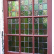 Damaged stained glass door panels restored