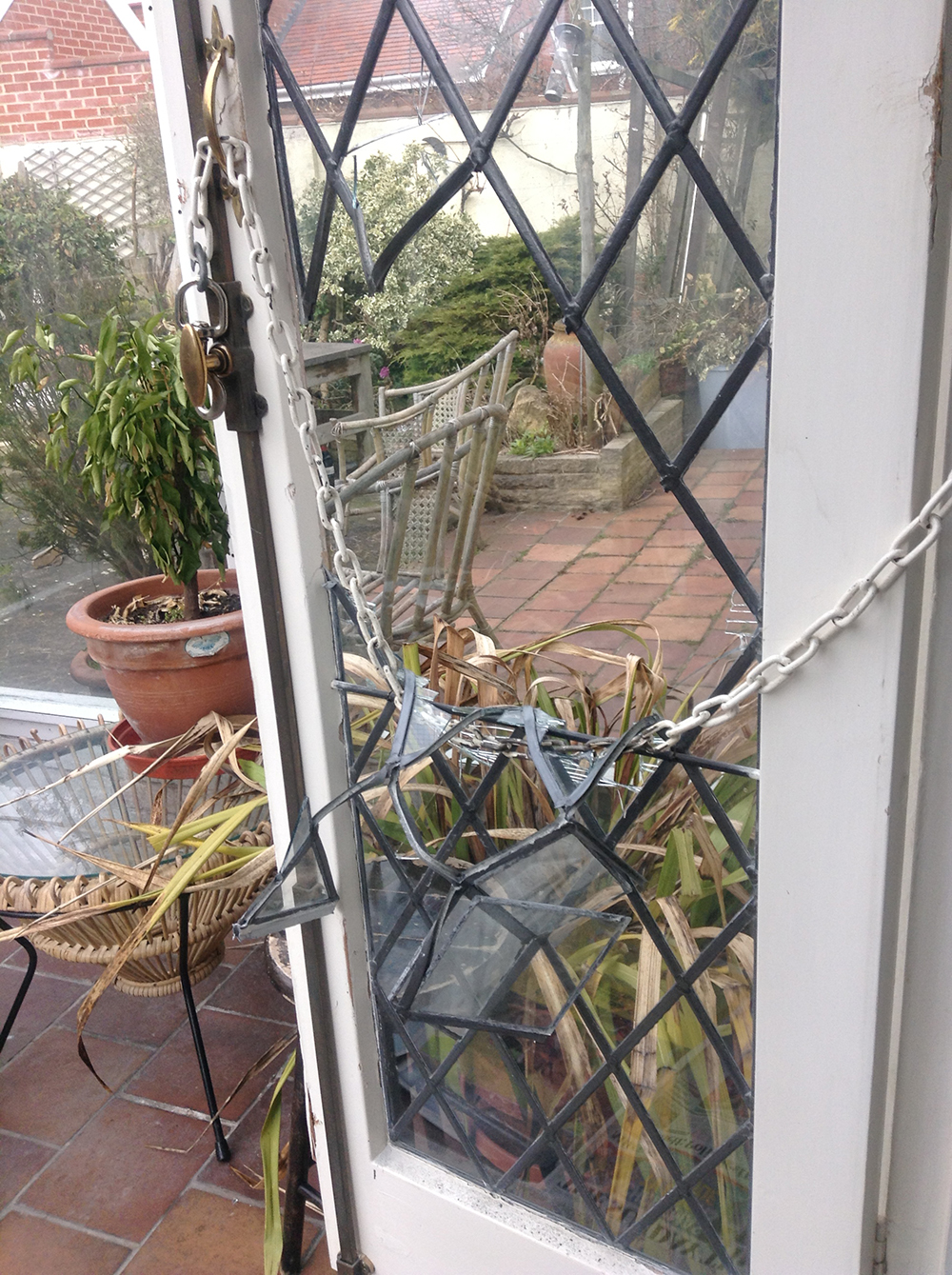 leaded glass French doors repaired after attempted break-in.